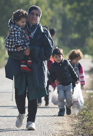Refugee woman with three children