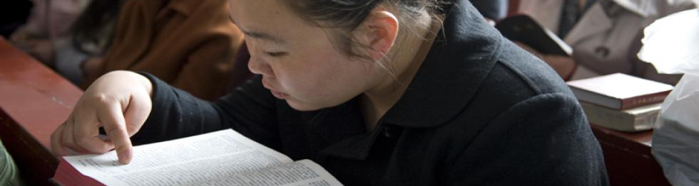 Chinese girl reading Bible