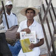 Cuban man with Bible