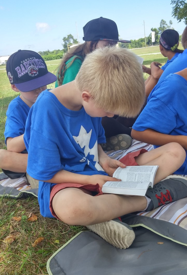 Children reading Bibles at Sports Camp