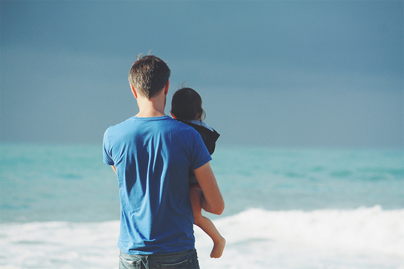 Father with child on the beach