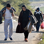 REFUGEES MAKE THEIR WAY TO THE CROATIAN BORDER CROSSING IN SERBIA NEAR THE VILLAGE OF BERKASOVO .